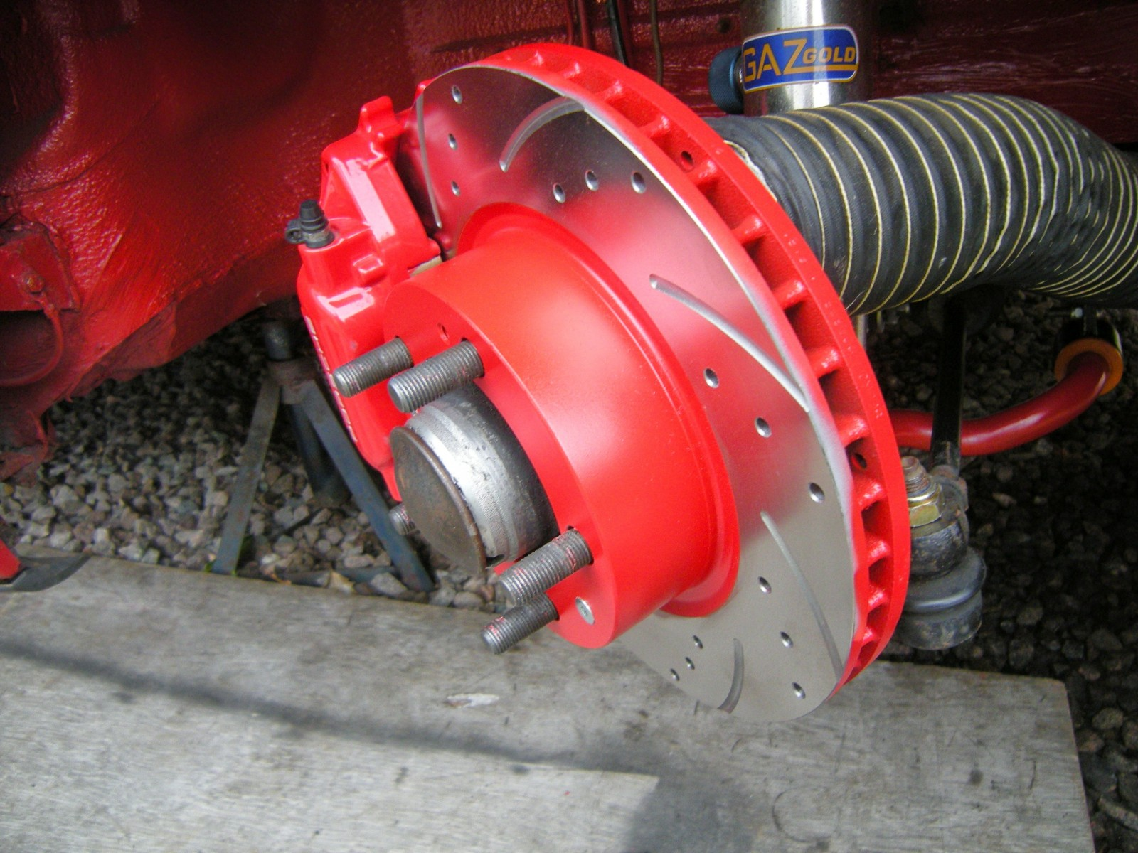 drilled and grooved discs with reconditioned calipers
