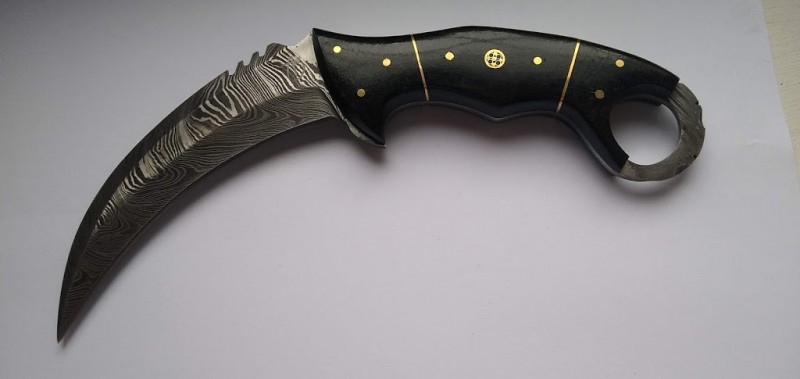 damascus bladed karambit, stag horn handle